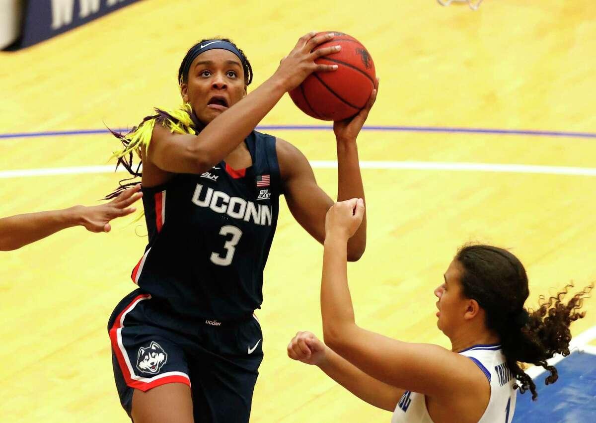 UConn forward Aaliyah Edwards (3) drives to the basket against Seton Hall forward Skylar Treadwell during the second half of an NCAA basketball game on Tuesday, Dec.15, 2020, in South Orange, N.J. (AP Photo/Noah K. Murray)