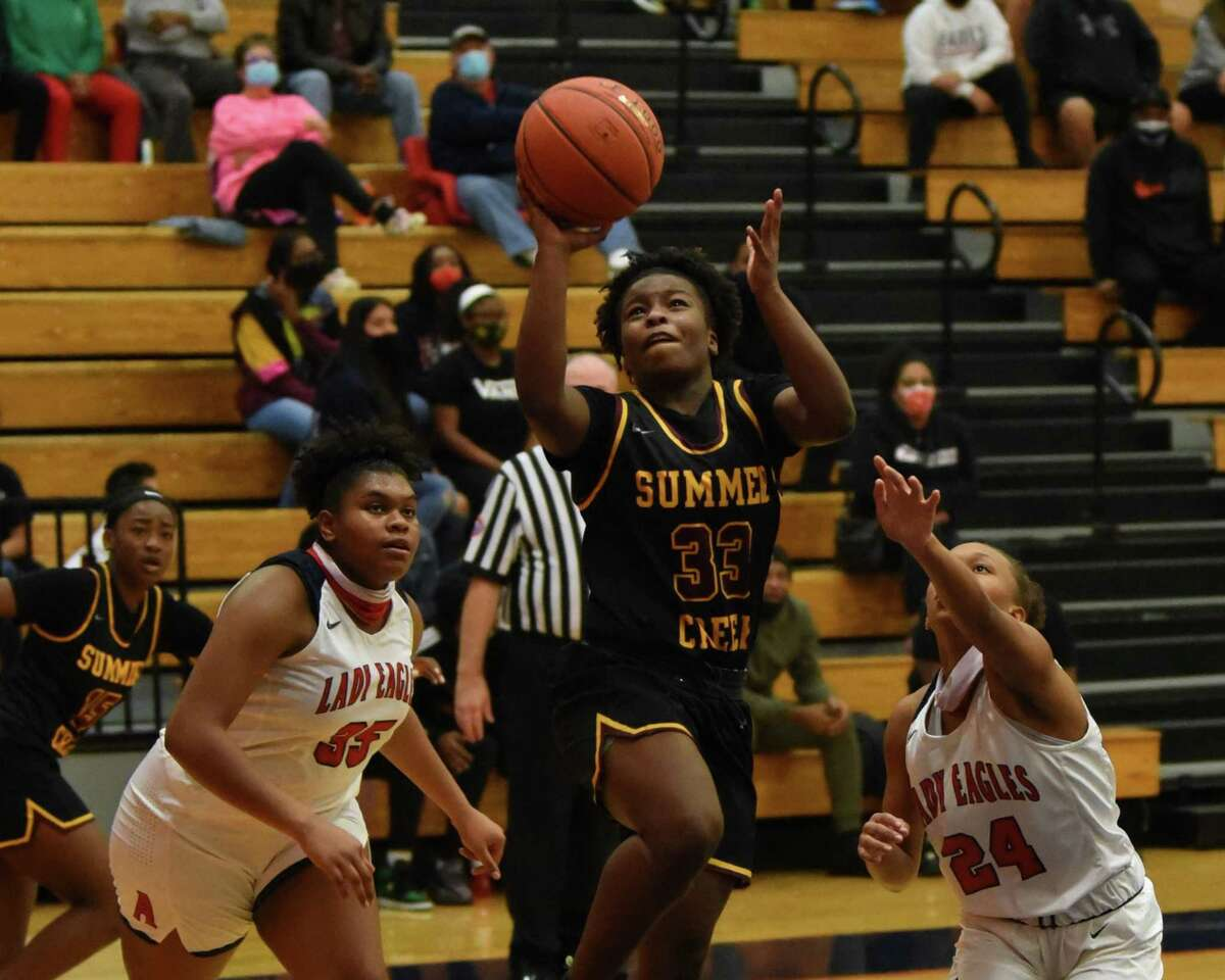 Summer Creek's Jayda Woods goes up for a layup against No. 20 Atascocita in a District 21-6A game at the Eagles gym.