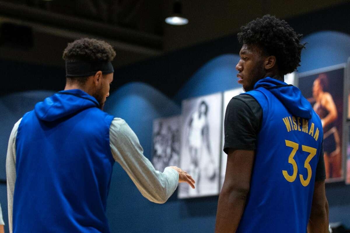 Warriors guard Stephen Curry (left) said rookie center James Wiseman