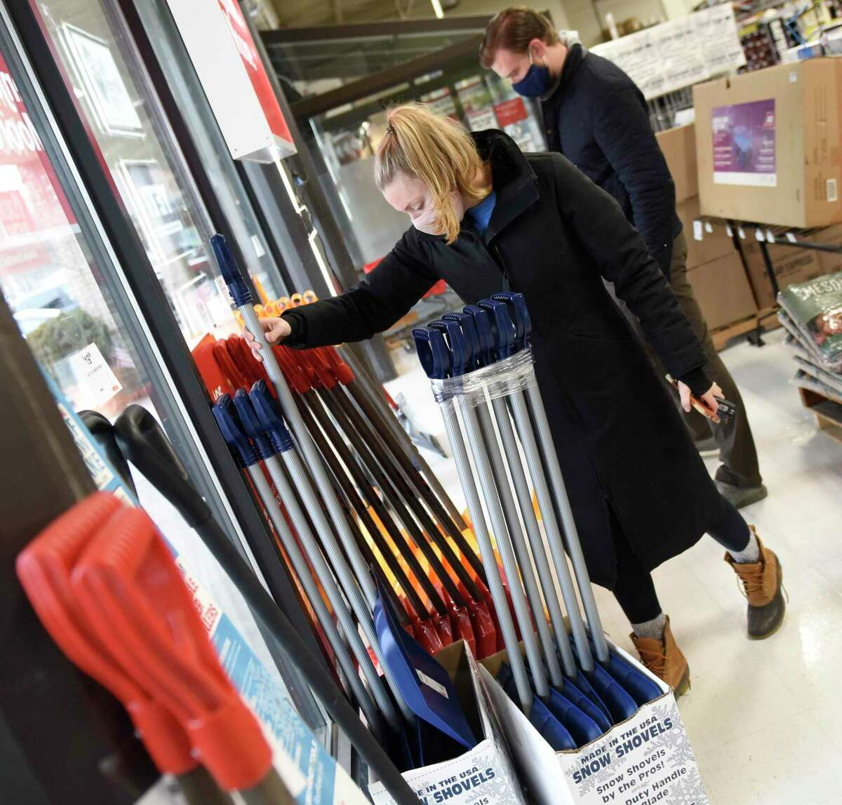 Stamford's Alexandra Maksimow and Tyler Ferraro pick out snow shovels at Karp's Ace Hardware in Stamford, Conn. Wednesday, Dec. 16, 2020. Folks stocked up on shovels, ice melt, and groceries in anticipation of the winter storm expected to dump more than a foot of snow starting Wednesday night.