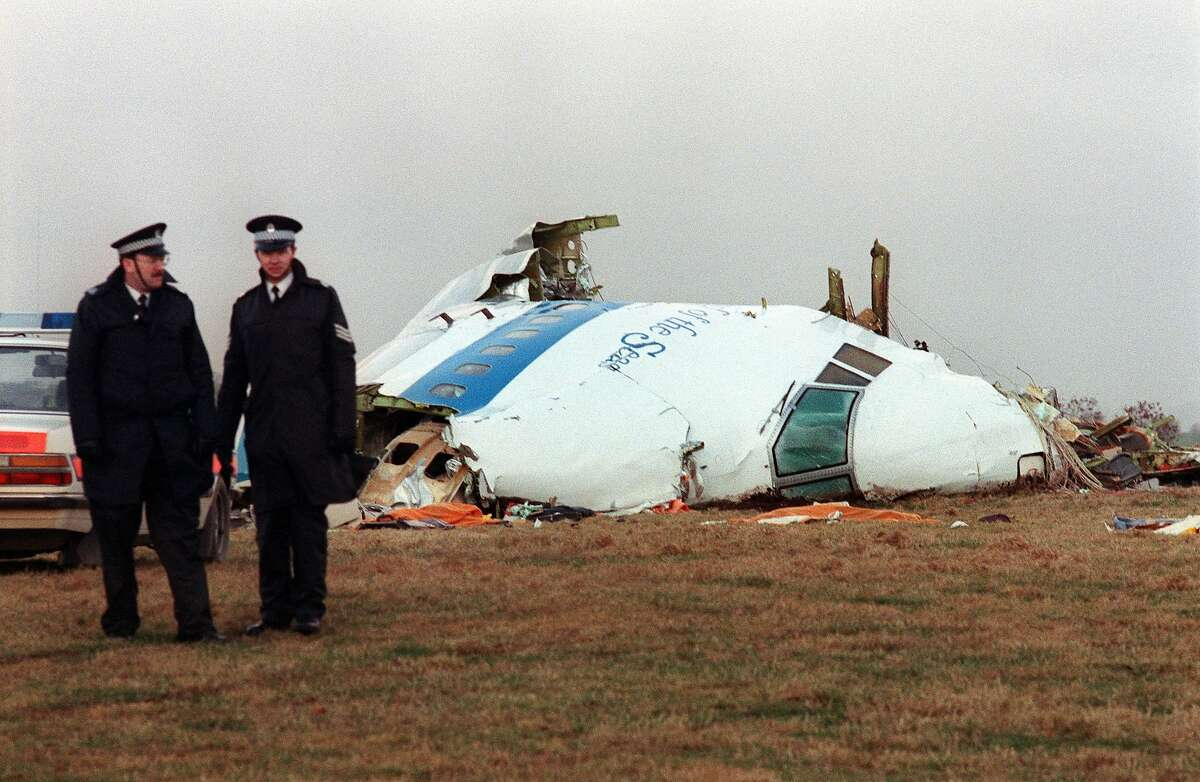 (FILES) In this file photo taken on December 22, 1988 Policemen stand near the wreckage of the 747 Pan Am airliner that exploded and crashed over Lockerbie, Scotland. The flight was on route for New York with 259 passengers on board. All 243 passengers and 16 crew members were killed as well as 11 Lockerbie residents. - A posthumous legal challenge to overturn the conviction of the Lockerbie bomber Abdelbaset Mohmet Al-Megrahi is due to begin in Scotland on November 24, 2020. Megrahi was the only person convicted of bombing Pan Am Flight 103, which was blown up as it travelled from London to New York over the Scottish town of Lockerbie on December 21, 1988. A total of 270 people from 21 countries were killed -- 243 passengers, 16 crew, and 11 people on the ground -- in what remains Britain's biggest terrorist attack. (Photo by ROY LETKEY / AFP) (Photo by ROY LETKEY/AFP via Getty Images)