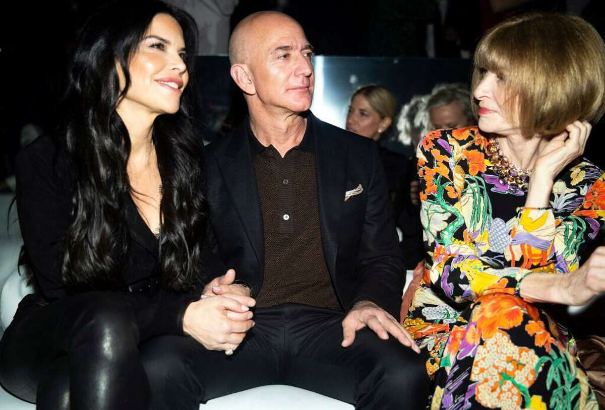 Amazon's chief executive, Jeff Bezos, with his girlfriend, Lauren Sanchez, left, and the fashion editor Anna Wintour at a fashion show in Los Angeles, Feb. 7, 2020. Luxury brands were late to embrace e-commerce. When they did, many depended on either Farfetch or Yoox, rejecting the overtures of giants like Amazon.