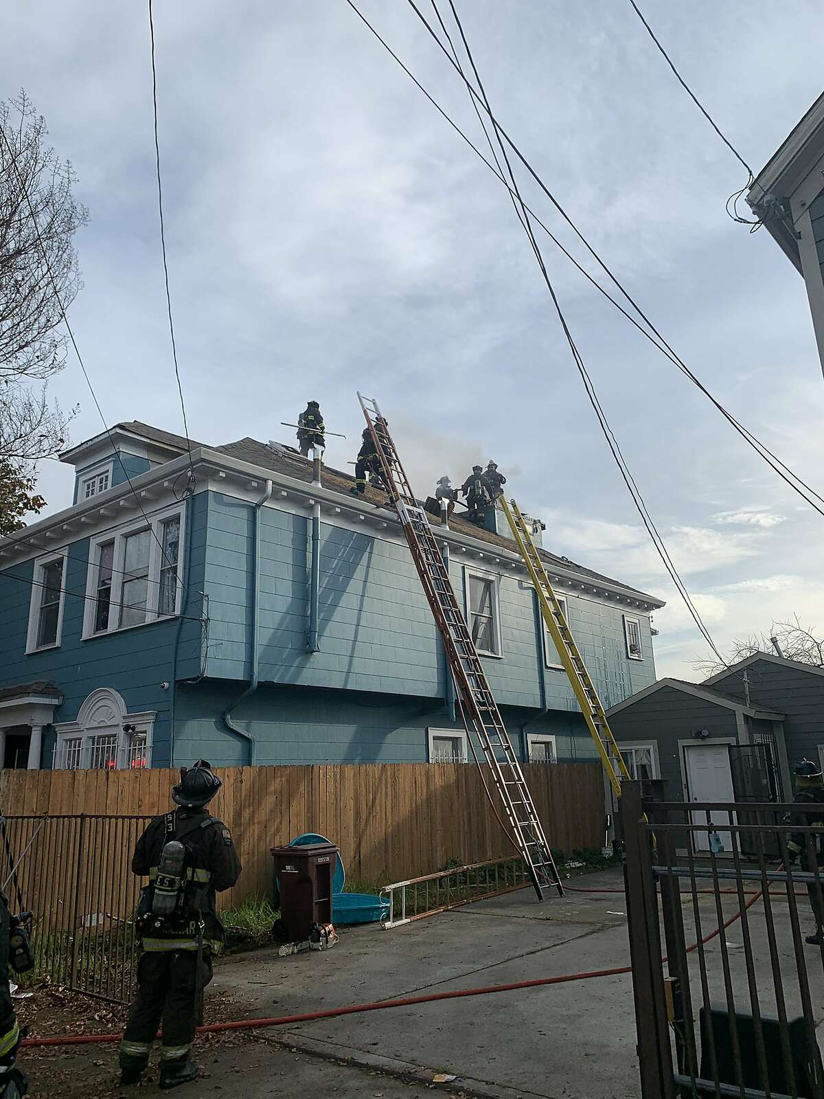 Nine people were displaced from a fire that damaged two residences in Oakland on Wednesday afternoon, Oakland Fire Department officials said. No injuries were reported shortly before 3 p.m Wednesday., but six adults and three children were displaced from the fire, Oakland fire officials said.
