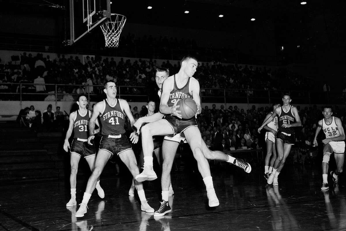 Basketball -- UCLA vs Stanford, 21 February 1958. 'Sports'. (Sleeve reads: SP 12286).;Supplementary material lists: 'UCLA Bruins' alphabetical roster;Stanford Indians' alphabetical roster'. (For a complete list, please see original).. (Photo by Los Angeles Examiner/USC Libraries/Corbis via Getty Images)