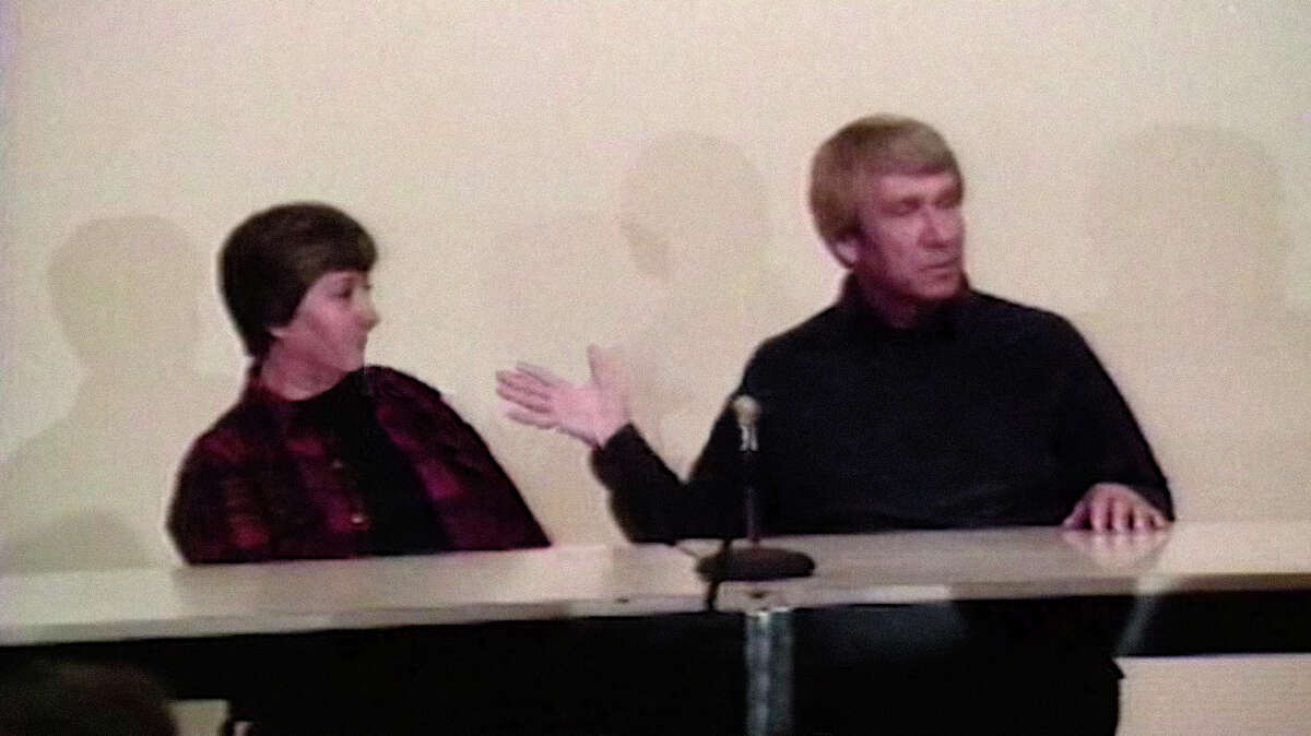Bonnie Nettles and Marshall Applewhite lead an informational meeting for the Heaven's Gate cult in this undated still from the HBO Max show