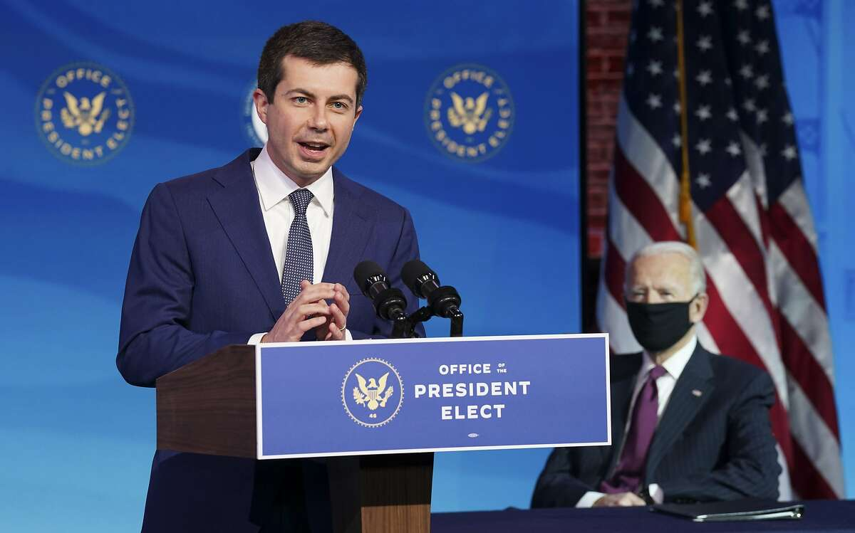 Former Democratic presidential candidate Pete Buttigieg speaks Dec. 16, 2020, as U.S. President-elect Joe Biden looks on after Buttigieg was named as Biden's pick to be secretary of Transportation.