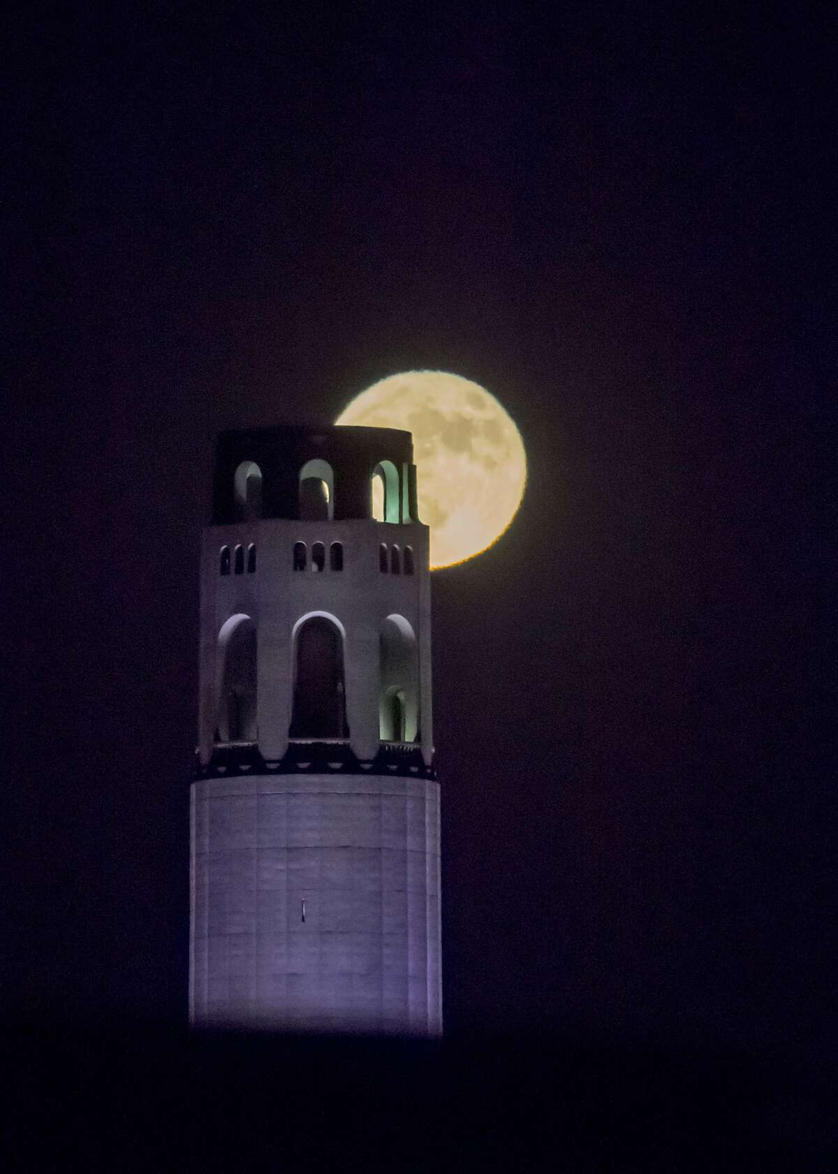 The Halloween Blue Moon, or second full moon of the month, rose behind Coit Tower as seen in San Francisco on Saturday, October 31, 2020. The full moon was the first day of Halloween to be visible in most time zones on Earth since 1944, and they will not happen again until 2039.