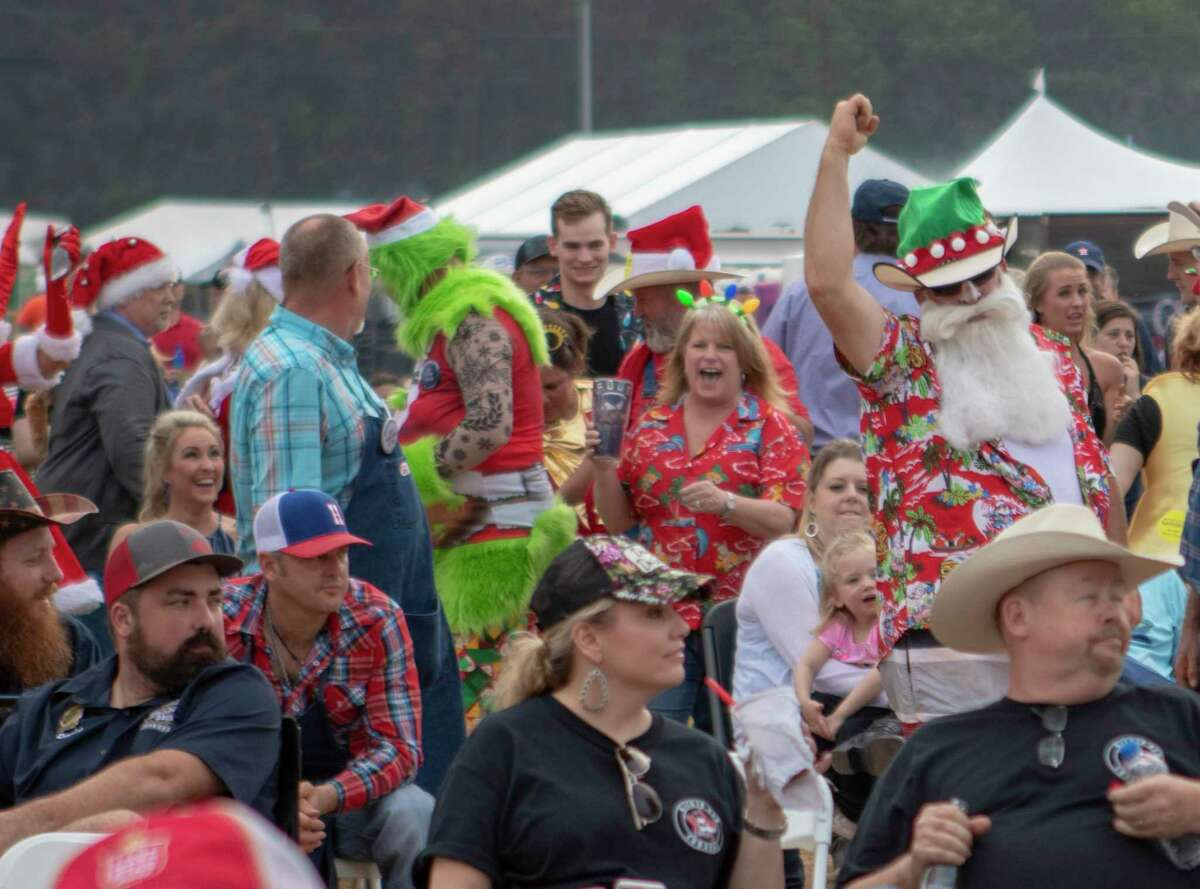 Members of Texas Chowboys celebrate after being awarded most congenial during the awards ceremony for the Bud Light BBQ Cook-Off on Saturday, April 6, 2018, at the Montgomery County Fair & Rodeo in Conroe. The Montgomery County Fair Association plans to move forward with a full schedule at the 2021 fair and rodeo in April.