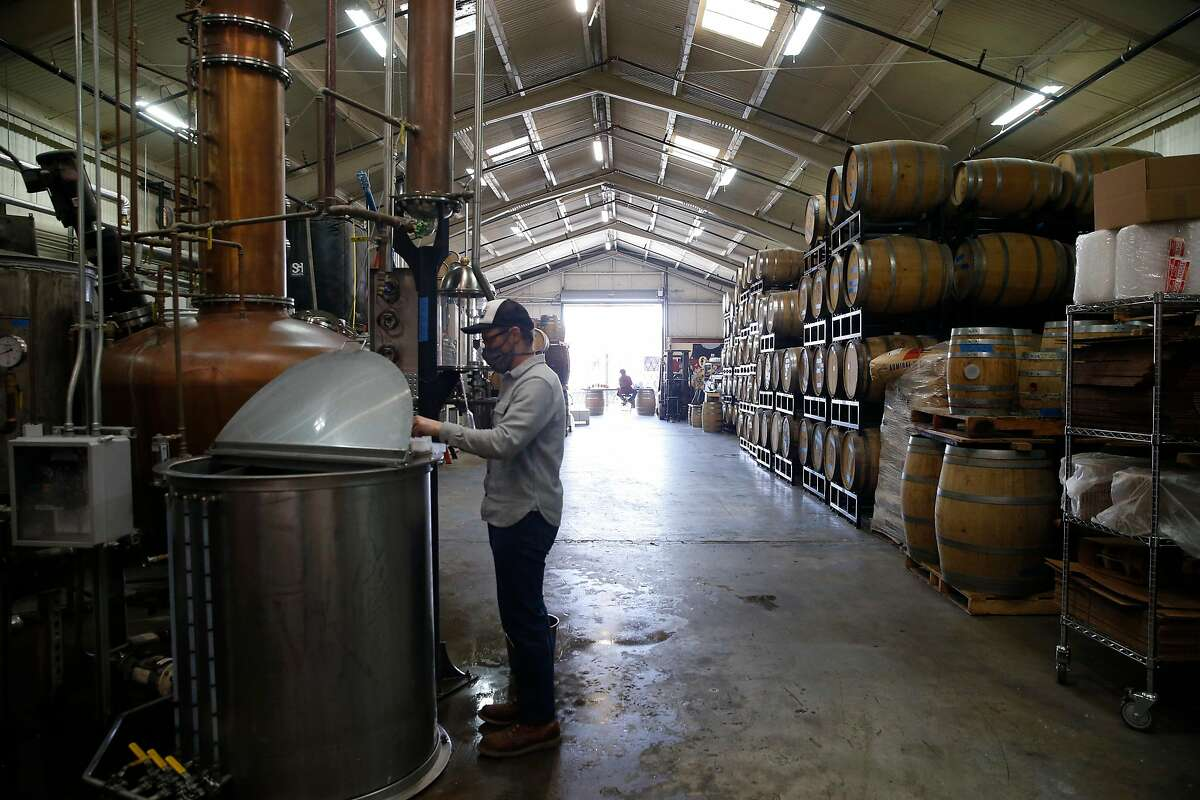 Earl Brown produces whiskey at Wright & Brown Distilling Co. in Oakland.
