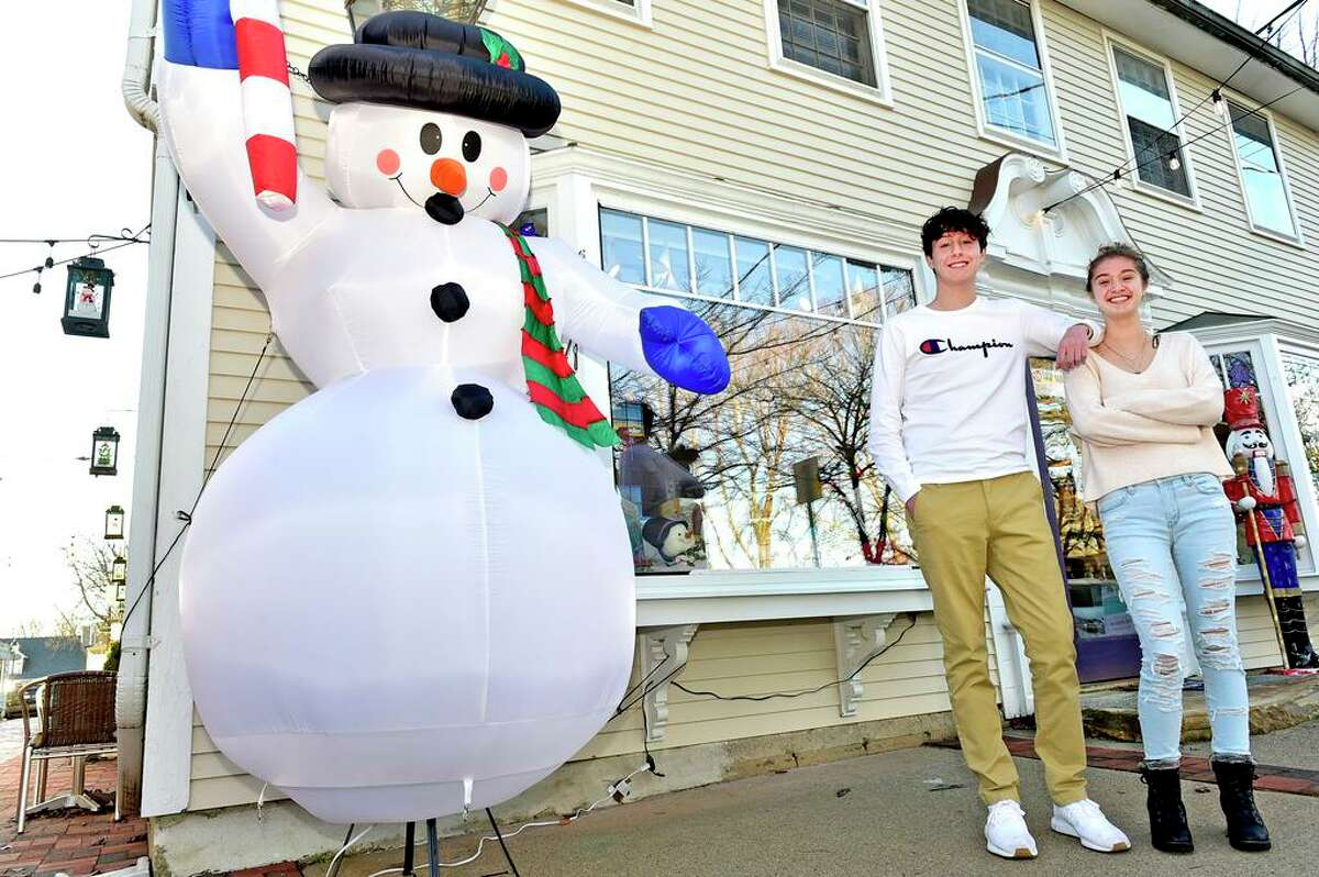 Nicky Amter, 17, and his sister Gianna Amter, 15, have set up a secret snowman program in downtown Guilford to not only brighten the holiday for local people, but also to encourage residents to shop local.