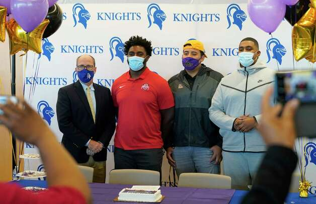 Head Coach Steve Leisz, left, poses with Donovan Jackson, Luis Chavarria and Cullen Montgomery, right, after a signing event at Episcopal HS 4650 Bissonnet St., Wednesday, Dec. 16, 2020 in Bellaire.  Donovan Jackson signed with Ohio State. Luis Chavarria signed with Prairie View. Cullen Montgomery signed with Oklahoma. Photo: Melissa Phillip, Staff Photographer / © 2020 Houston Chronicle
