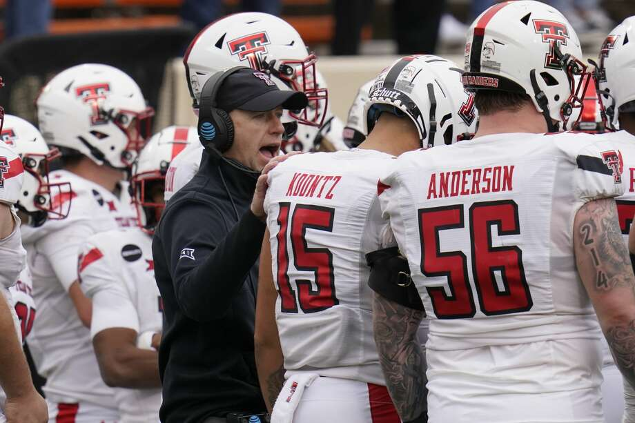 Texas Tech head coach Matt Wells talks with his players during a time out in the second half of an NCAA college football game against Oklahoma State in Stillwater, Okla., Saturday, Nov. 28, 2020. (AP Photo/Sue Ogrocki) Photo: Sue Ogrocki/Associated Press / Copyright 2020 The Associated Press. All rights reserved.