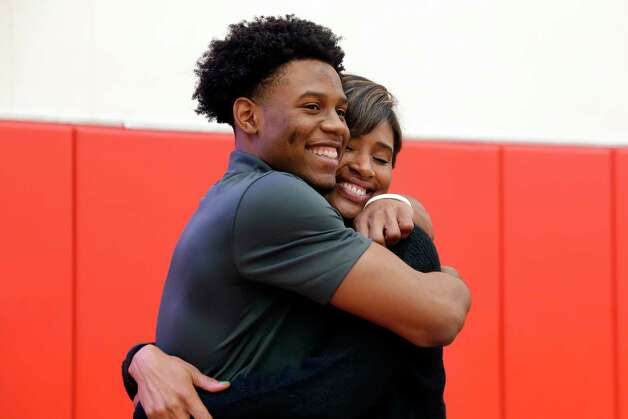 Cameron Bonner hugs his mother NaKea Bonner after signing day ceremonies at the St. Thomas High School gymnasium Wednesday, Dec. 16, 2020 in Houston, TX. Bonner signed with Baylor University. Photo: Michael Wyke, Contributor / © 2020 Houston Chronicle