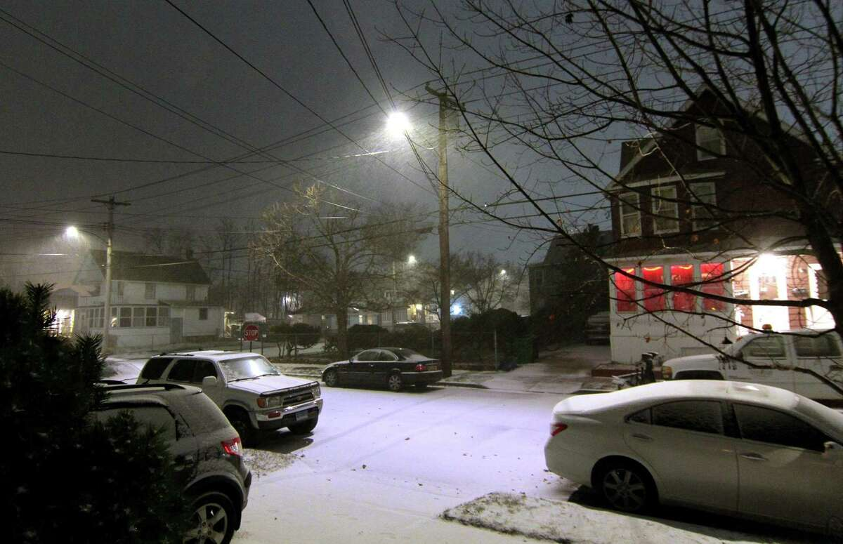 Snow starts to accumulate on Anderson Ave. as a major snowstorm starts to hit the region in West Haven, Conn., on Wednesday Dec. 16, 2020.
