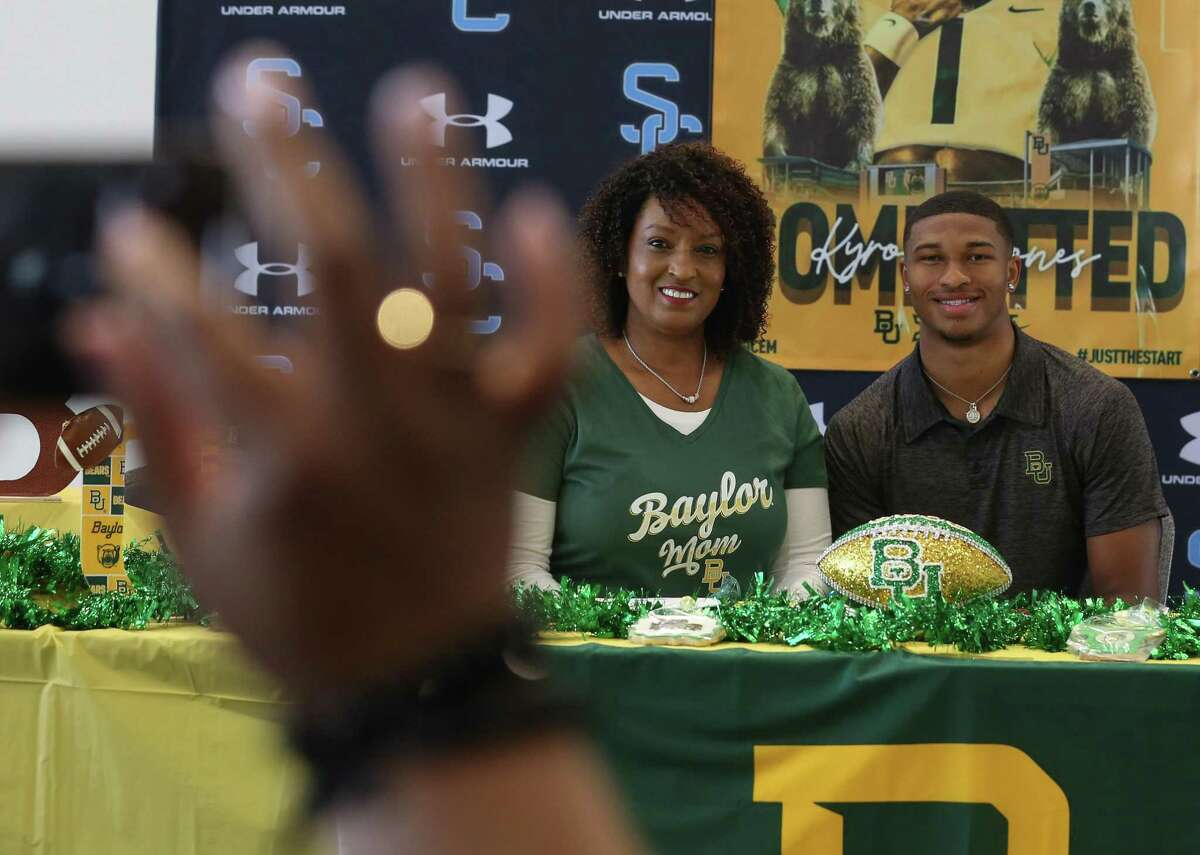 Shadow Creek's Kyron Drones and his mother, Olinka, celebrate his signing with Baylor.