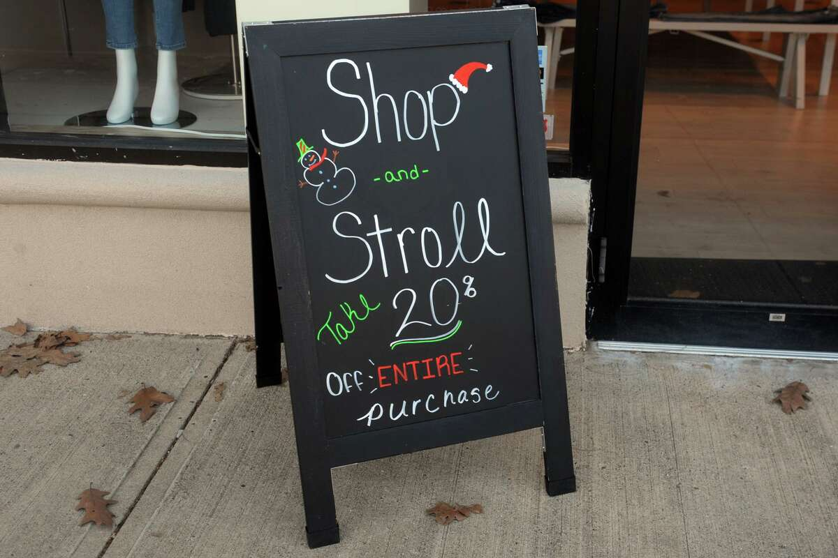 Signage for Shop & Stroll day along the Boston Post Rd., in Fairfield, Conn. Dec. 3, 2020.