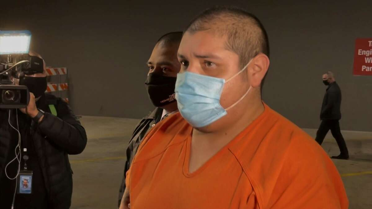 Rafael Castillo, 26, is escorted by deputies into the Bexar County Adult Detention Facility on Dec. 16, 2020, at 200 N. Comal Street. He was arrested and charged with murder in the death of 31-year-old Nicole Perry, who was found dead on Nov. 19 at a work site in Southeast Bexar County.