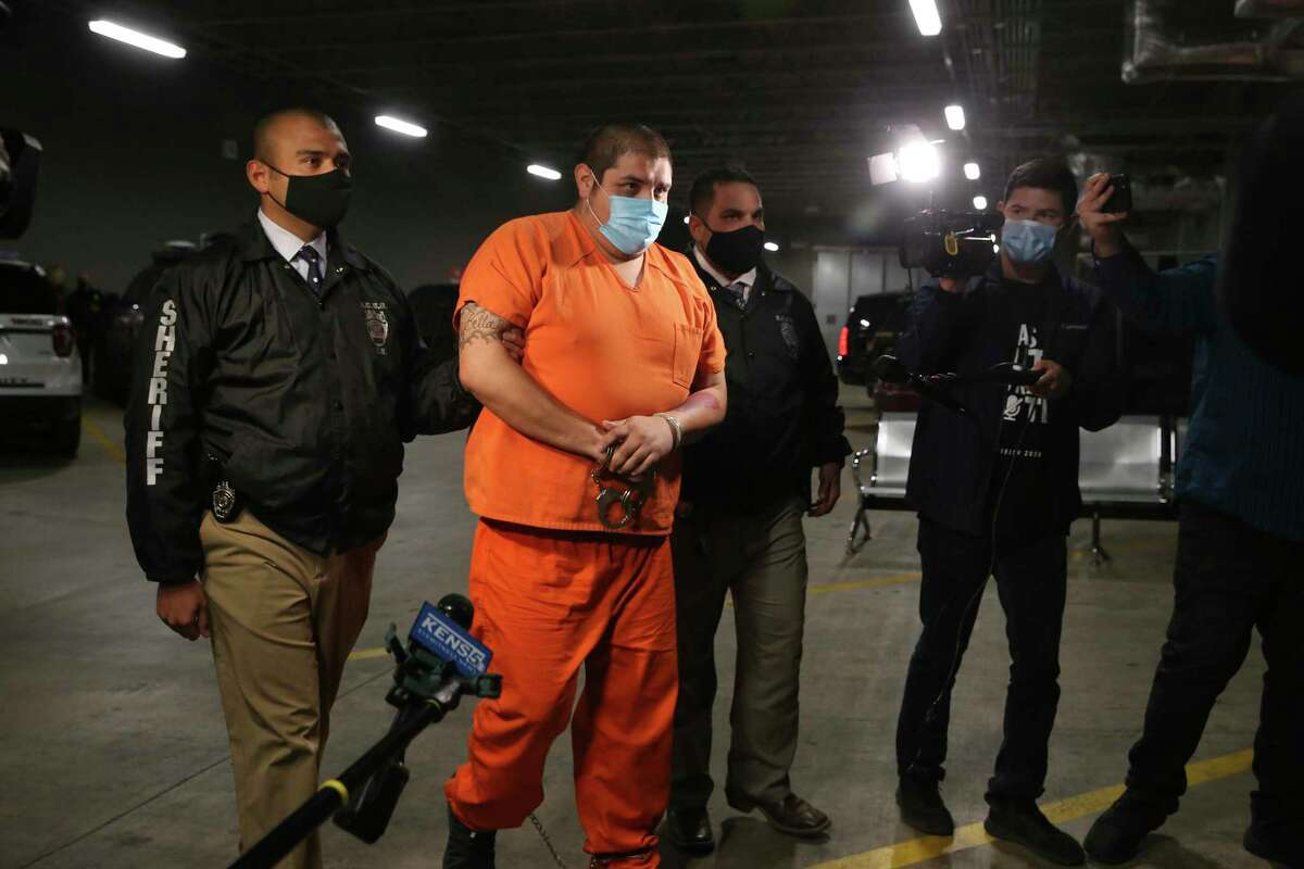 Rafael Castillo, 26, is led into the Bexar County Jail, Wednesday, Dec. 16, 2020. Castillo has been charged in the murder of Nicole Perry, 31. Perry's body was found was found wrapped in a tarp by a cleaning crew on S. WW White Road on Nov. 19. Castillo was arrested by a task force in Brownsville, Texas. They believe he killed Perry, with a hatchet or axe, at a home on West Harlan Avenue. They are still searching for body parts.