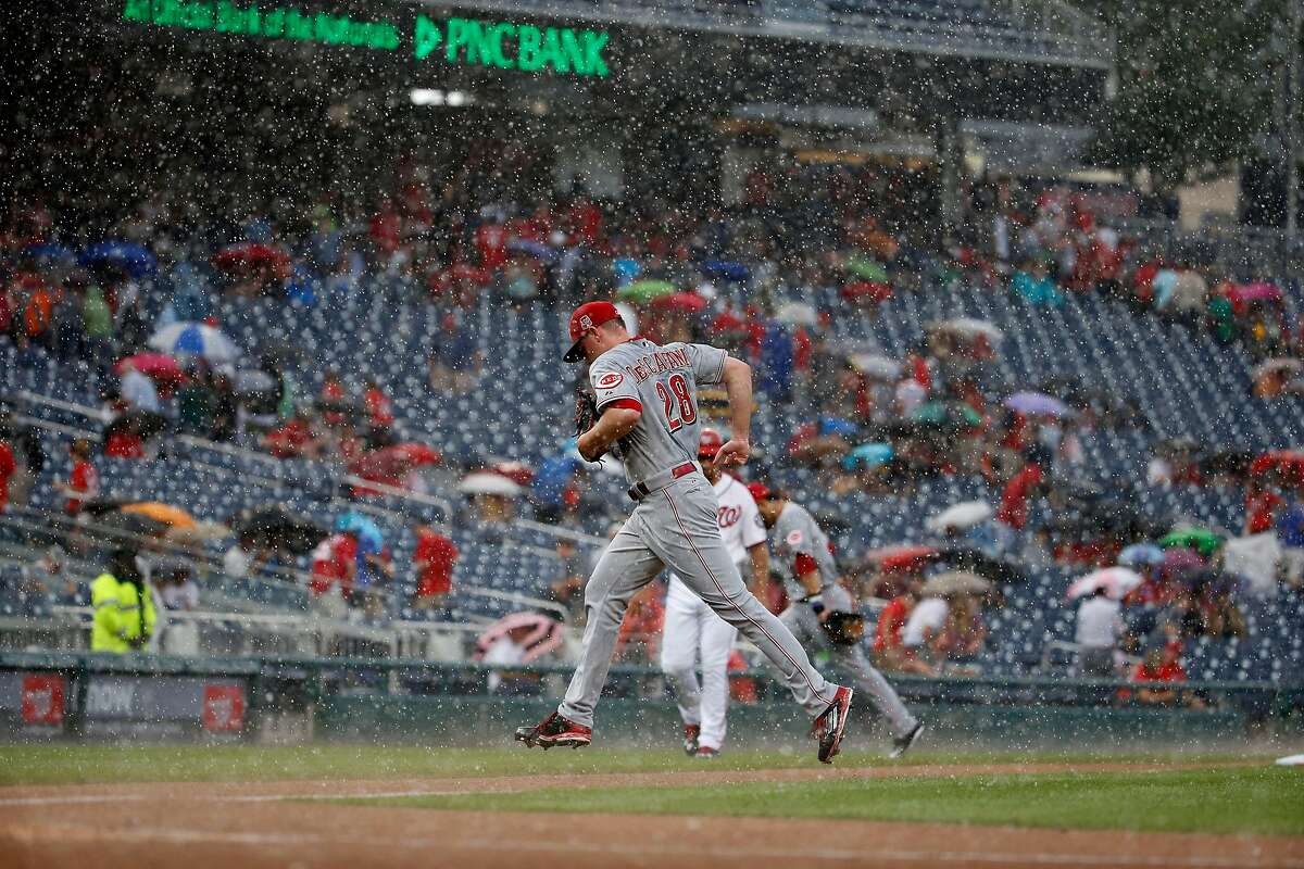 Cincinnati Reds starting pitcher Anthony DeSclafani (28) runs for the dugout as the game is delayed due to rain during the first inning of a baseball game against the Washington Nationals at Nationals Park, Monday, July 6, 2015, in Washington. (AP Photo/Alex Brandon)
