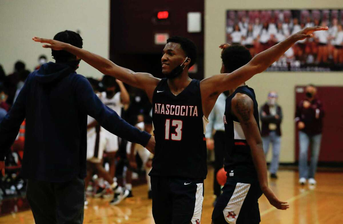 Atascocita point guard Justin Collins (13) reacts after the team's 68-58 win over Summer Creek during a District 21-6A high school basketball game at Summer Creek High School, Wednesday, Dec. 16, 2020, in Atascocita.