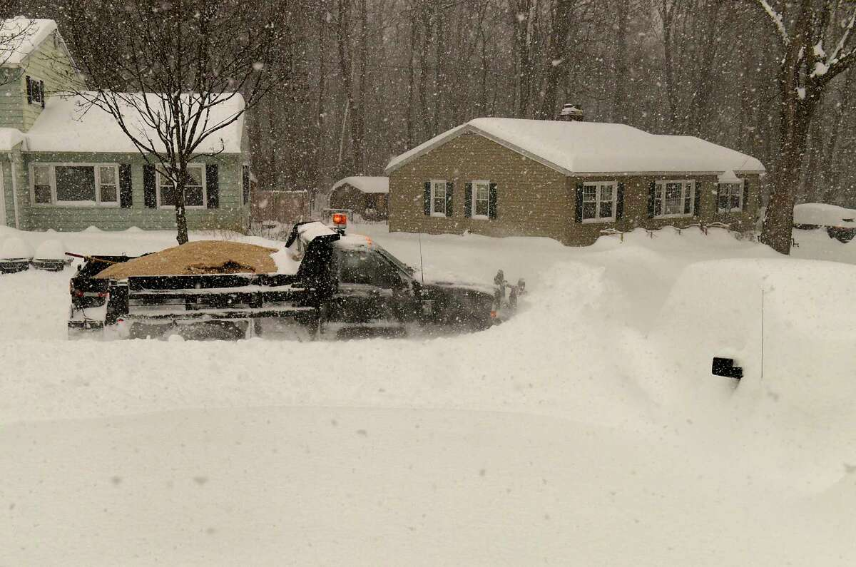 A plow is seen clearing a residential street during a nor'easter snow storm on Thursday, Dec. 17, 2020 in Guilderland, N.Y. (Lori Van Buren/Times Union)