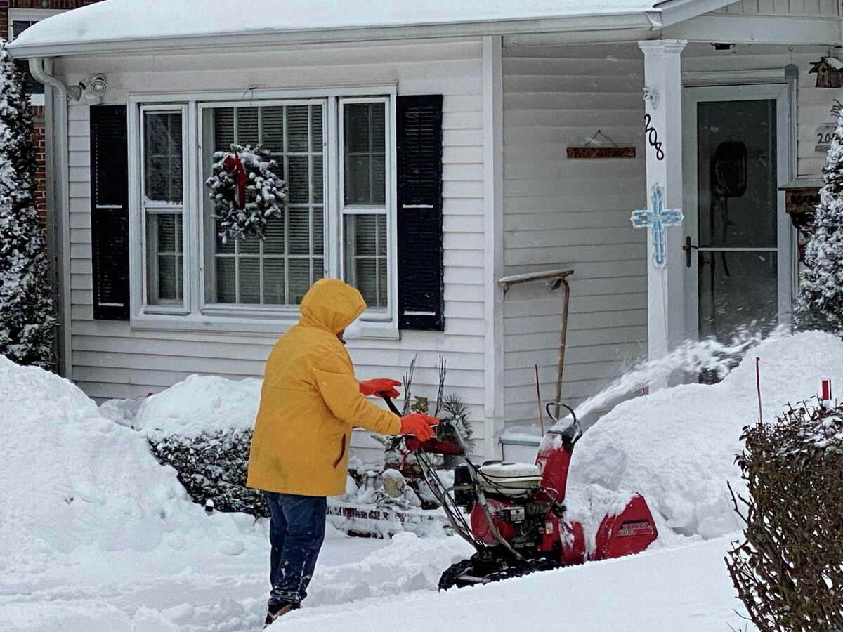 Man on Summer Street was out early as snow fell in New Canaan on Dec. 17, 2020.