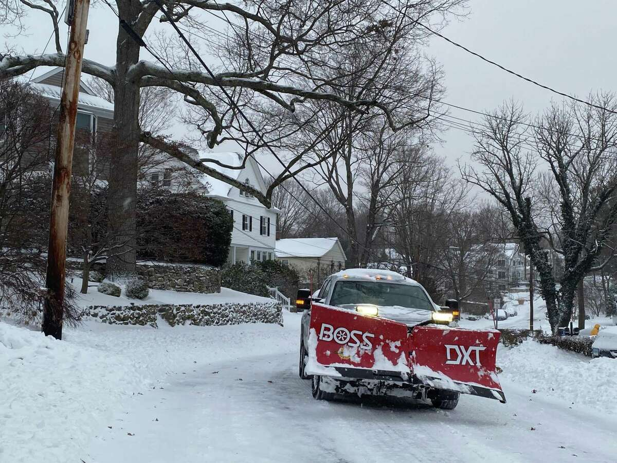 Plows were out as snow fell in New Canaan on Dec. 17, 2020.