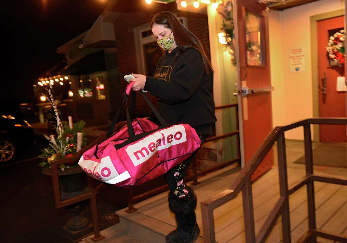 Albany County is limiting how much food delivery services can charge restaurants. In this photograph,Casey Maddalla picks up an order of food from a restaurant on Wednesday, Dec. 16, 2020 in Clifton Park. (Lori Van Buren/Times Union)
