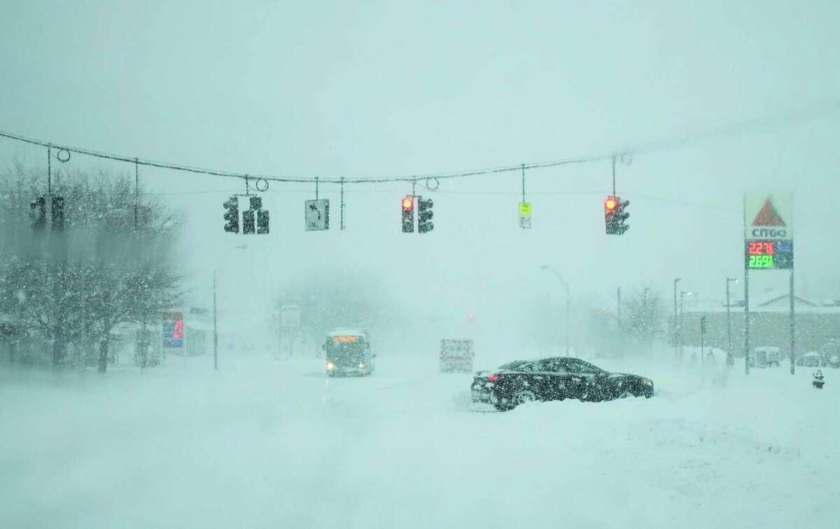 A vehicle is stuck in a snow bank on Thursday, Dec. 17, 2020, in Rensselaer, N.Y. (Paul Buckowski/Times Union)