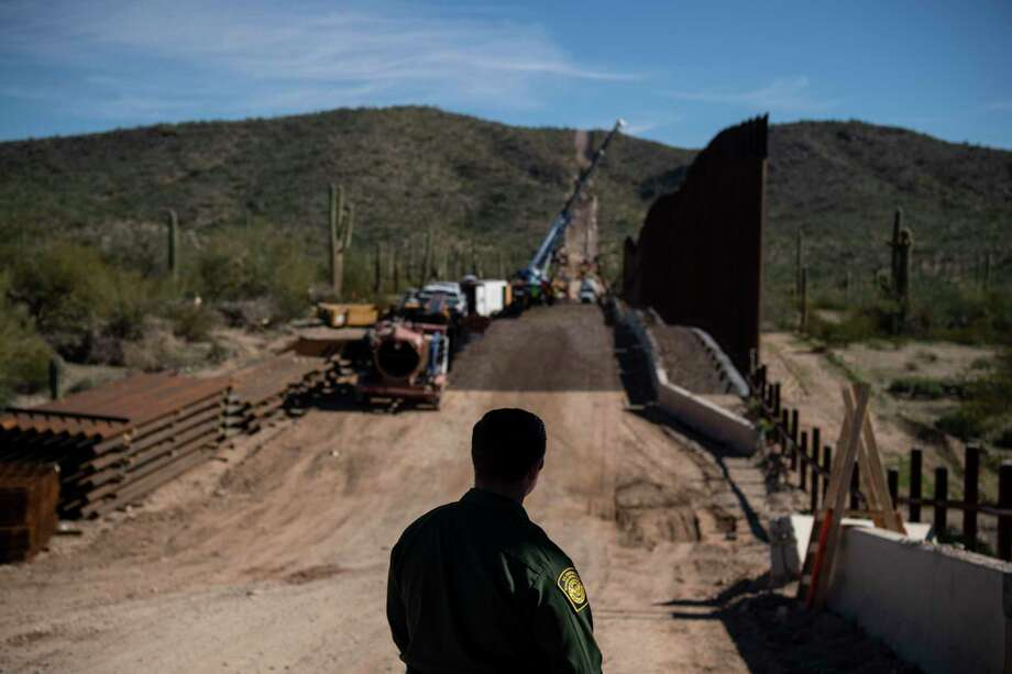 Border Patrol agent Joe Curran looks at fence construction in the Organ Pipe Cactus National Monument in Lukeville, Ariz. in January 2020. Photo: Carolyn Van Houten / The Washington Post / The Washington Post