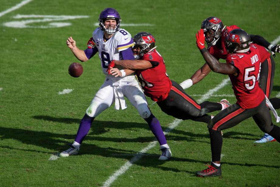 Tampa Bay Buccaneers strong safety Antoine Winfield Jr. (31) sacks and strips the ball from Minnesota Vikings quarterback Kirk Cousins (8) during an NFL football game, Sunday, Dec. 13, 2020, in Tampa, Fla. (AP Photo/Alex Menendez) Photo: Alex Menendez, FRE / Associated Press / Copyright 2020 The Associated Press. All rights reserved.