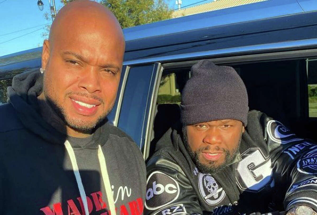Pictured: Turkey Leg Hut owner Lynn Price and rapper 50 cent at the restaurant on Dec. 16, 2020.