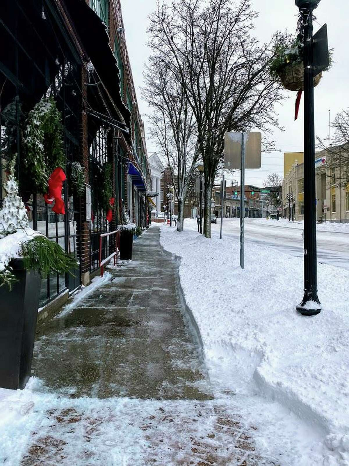 Snow lined North Main Street in Norwalk, Conn. on Dec. 17, 2020 after the area was hit with a storm that brought over 5 inches of snow.