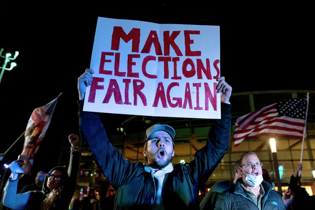 A supporter of President Donald Trump in November chants during a protest against the election results outside the central counting board at the TCF Center in Detroit. Trump has taught his opponents not to believe a word he says, his followers not to believe a word anyone else says, and much of the rest of the country to believe nobody and nothing at all.