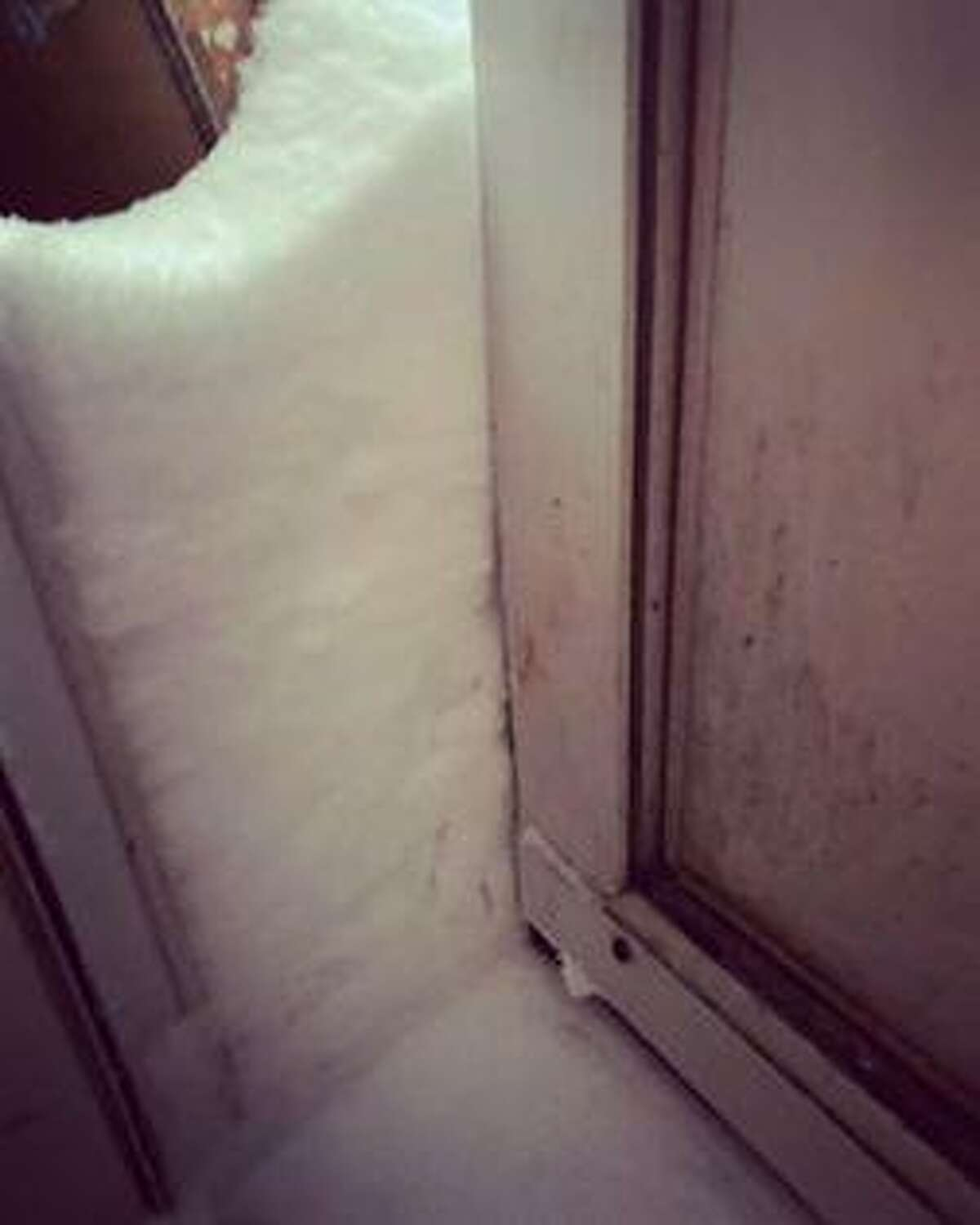 Bantam resident Jaymee Farkas couldn't get out her door this morning, due to snow pile-up.