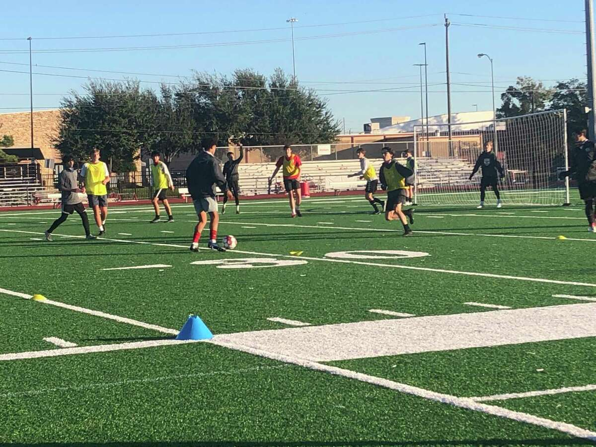 The Memorial boys soccer team practices on the morning of Dec. 7