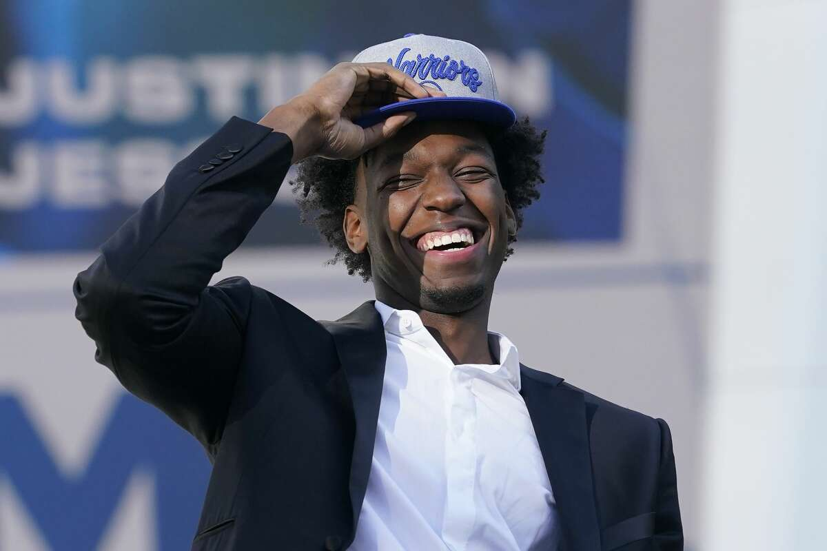 In this Nov. 19, 2020, file photo, Golden State Warriors draft pick James Wiseman laughs during a news conference in San Francisco. The 7-foot-1 Wiseman played only three college games as a freshman at Memphis. (AP Photo/Jeff Chiu, File)