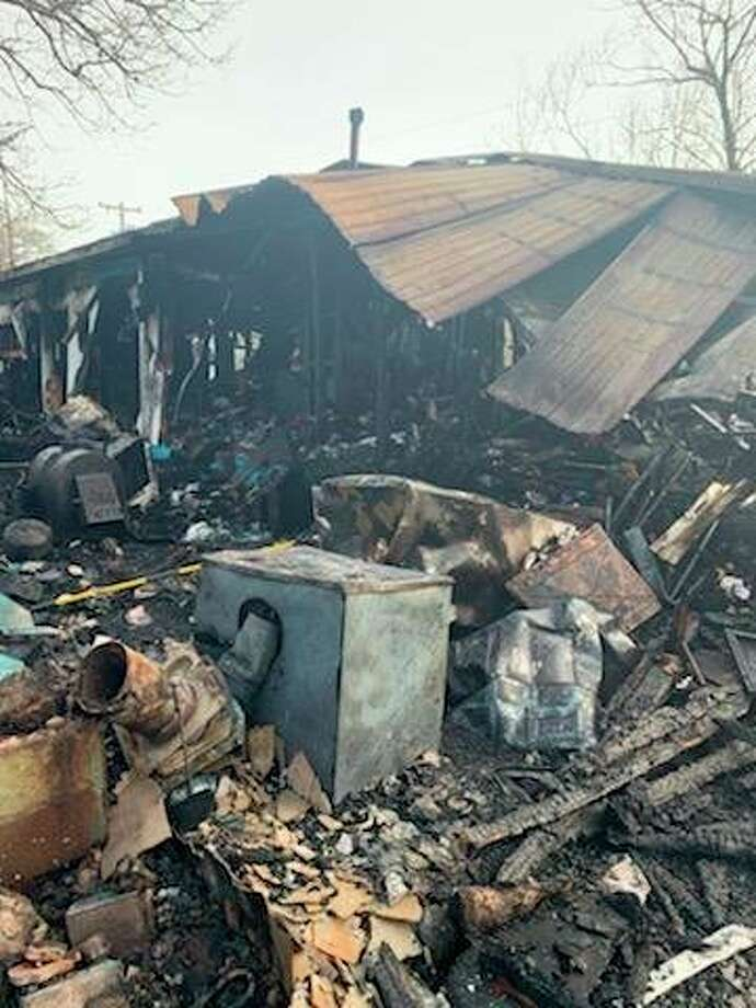 A burned mobile home with an addition in Stronach Township is considered a complete loss and unsafe to enter after a fire Wednesday. (Courtesy photo/Wayne Lindeman)