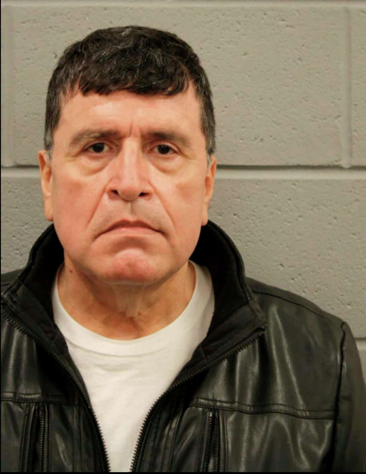 An undated booking photo provided by the Houston Police Department of Mark Aguirre, a former Houston police captain. Aguirre, who authorities said was investigating a voter fraud conspiracy theory for a conservative activist group, was arrested and charged with pointing his gun at an air-conditioner repairman he had pursued to try to uncover fraudulent ballots, according to prosecutors.