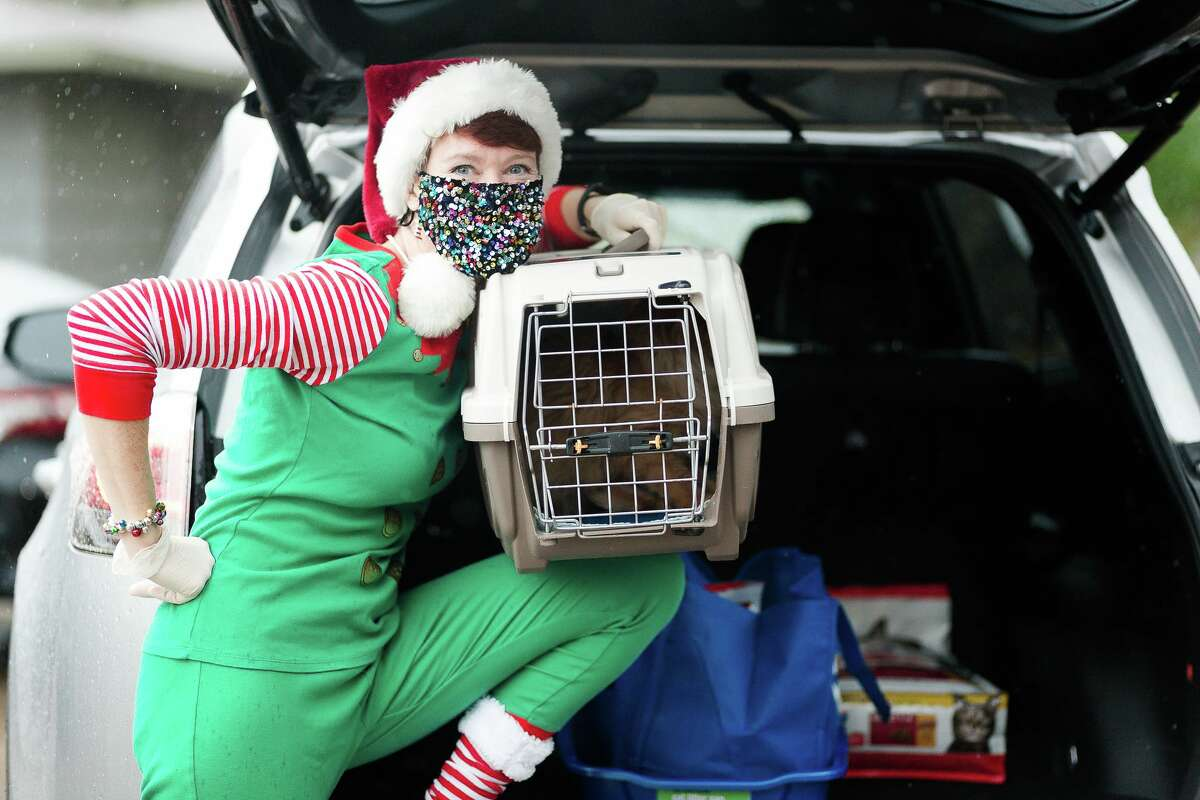 Houston SPCA and BakerRipley employees dressed up as elves delivered Thomas.