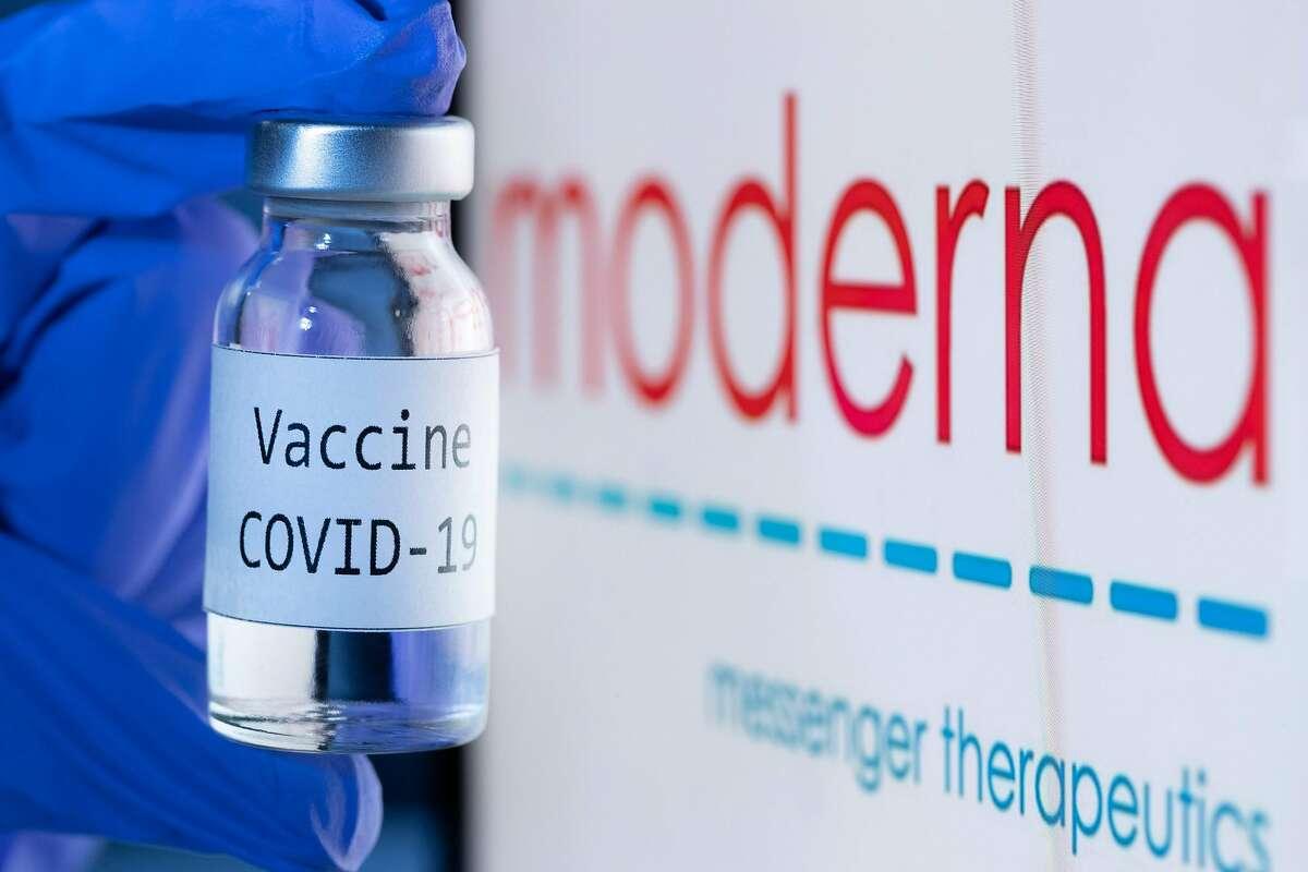 "Thi photo taken on Nov. 18, 2020 shows a bottle reading ""Vaccine Covid-19"" next to the Moderna biotech company logo."
