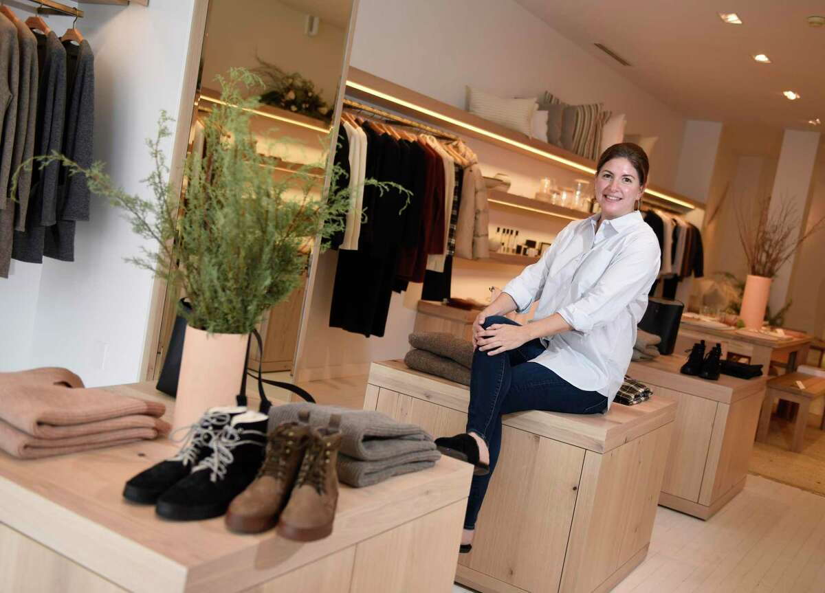 Store manager Katja Shrouder poses inside the Jenni Kayne store in Greenwich, Conn. Monday, Dec. 7, 2020. The California-based lifestyle clothing and home store opened on Greenwich Avenue two weeks ago, joining two New York City stores as the company's first expansions to the east coast.