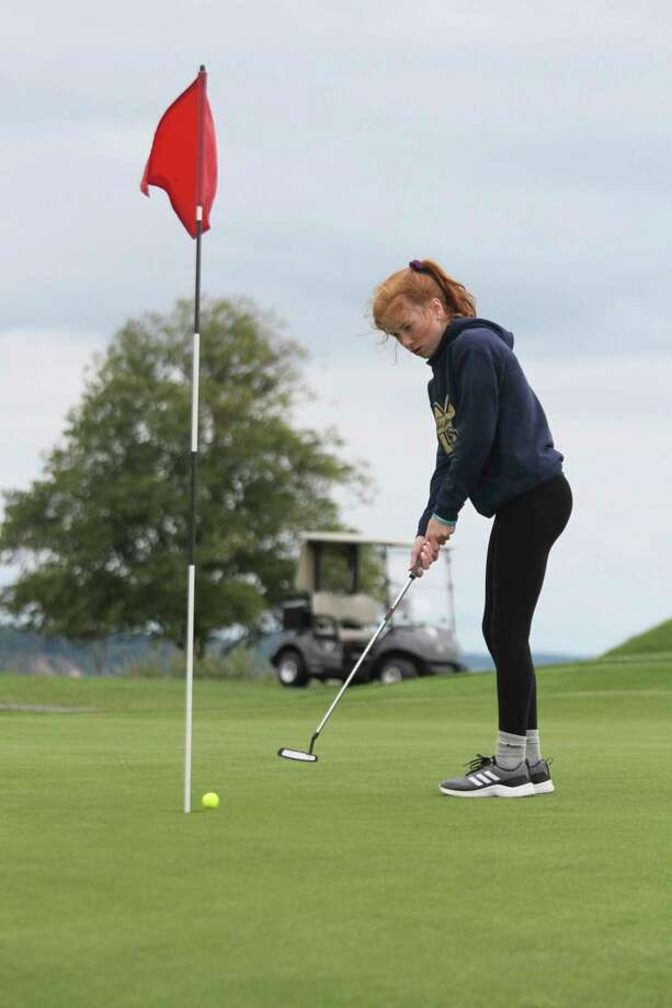 Manistee's Kendal Waligorski sinks a putt this past season. The Chippewas were recently named academic all-state. (News Advocate file photo)