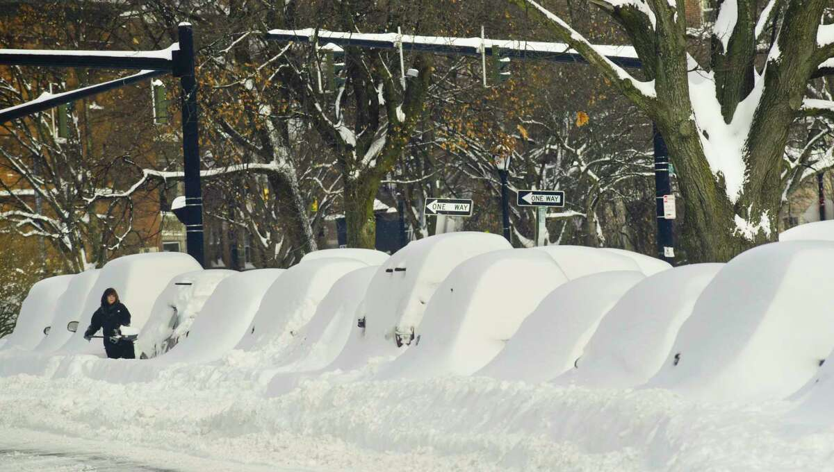 Cars are buried in snow on Washington Park Road on Thursday, Dec. 17, 2020, in Albany, N.Y. (Paul Buckowski/Times Union)