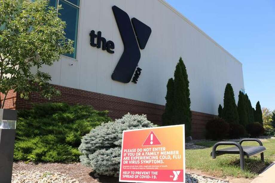 A sign outside the Edwardsville Meyer Center YMCA warns of COVID-19 restrictions Photo: For The Intelligencer