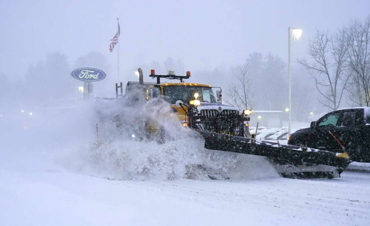 Snow plows should be back on the road Tuesday. The National Weather Service says a storm could drop up to 4 inches of snow in Albany. In this photograph, asnow plow clears snow off of Columbia Turnpike on Thursday, Dec. 17, 2020, in East Greenbush, N.Y. (Paul Buckowski/Times Union)