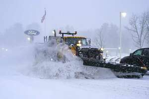 A snow plow clears snow off of Columbia Turnpike on Thursday, Dec. 17, 2020, in East Greenbush, N.Y.   (Paul Buckowski/Times Union)