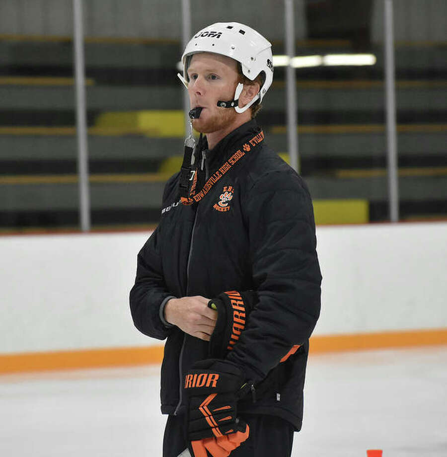 Edwardsville coach Jason Walker watches an August practice from center ice at the East Alton Ice Arena. Photo: Matt Kamp|The Intelligencer