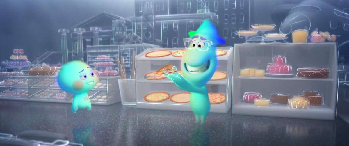 This image released by Disney-Pixar shows the character 22, voiced by Tina Fey, left, and Joe Gardner, voiced by Jamie Foxx, in a scene from the animated film