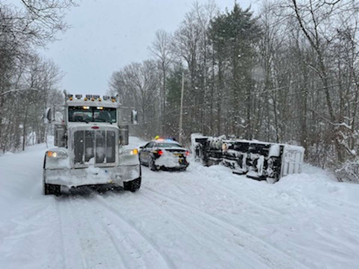 A tow truck hauls town plow out of ditch on Fort Edward Road on Thursday, Dec. 17.